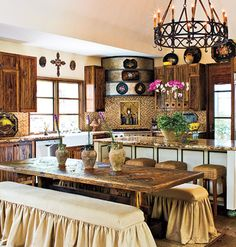 Weathered Wood    In this old-world kitchen, salvaged wood flooring inspires the entire space (and is an eco-friendly choice). Leftovers from the flooring were used to create the dining table, and pecky cypress kitchen cabinets complement the warm wood throughout.