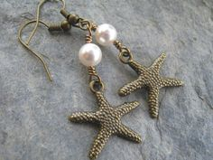 Personalized Starfish Pearl Earrings BRONZE by Abundantearthworks  Choose your Pearls  #starfish #starfishearrings #pearlearrings #beachearrings #pearl #beachwedding #nautical #bronze #bohoearrings #shellearrings #bridesmaidgift #dangleearrings #personalizedearrings #abundantearthworks