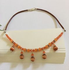 Necklace-Orange Fiber Optic Cat Eye Beaded With Charm Dangles on Leather Cord-Bib Style Necklace-18 Inches-Tangerine Orange-Rusty Orange