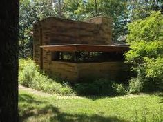 Seth Peterson Cottage, by Frank Lloyd Wright - Bing Images  There is an additional double sleeping space that folds out of the corner bench seating. The efficient kitchen accommodates everything. The central focus is a massive stone fireplace with views of the surrounding forest and Lake.