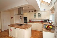 Cream shaker style kitchen cabinets and mock butcher block worktops. Shaker Style Kitchen Cabinets, Shaker Style Kitchens, 1930s Home Decor, Open Plan Kitchen Dining, Luxurious Bedrooms, Modern Bedroom, Dining Room, Room Ideas, Nottingham