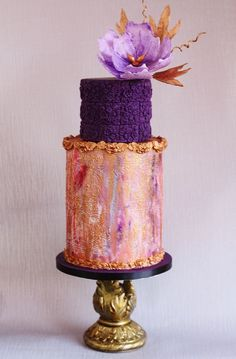 Such a beautiful purple and peach combination on this pretty cake with wafer paper flowers. | purple wedding | www.endorajewellery.etsy.com
