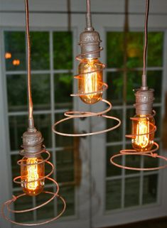 Love these pendant lamps with upcycled bed springs. $50