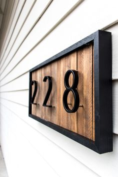 DIY a modern house number sign with wood shims to improve your curb appeal. This unique address plaque is simple to make and looks great! The post DIY a modern house number sign with wood shims to improve your curb appeal. This appeared first on Diy. Diy Casa, Address Plaque, Home Address Signs, Diy Holz, Diy Décoration, Sell Diy, First Home, Black House, Home Projects