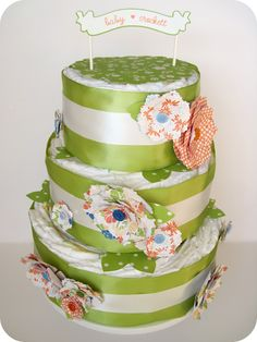 Practical Diaper Cake. Diapers are stacked instead of rolled, making it easier for the new baby to use them.