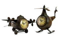 A quirky pair of helicopter clocks with handsome aged-bronze metal finish will make time in the office fly by.