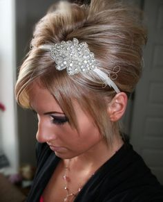 Rhinestone Bridal Feather Headband, Wedding hair piece, bridal headpiece, accessories, crystal. $27.95, via Etsy.