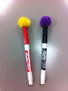 What a great idea for whiteboard markers - attach a pompom to the marker cap ... have an instant whiteboard eraser.