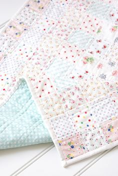 MessyJesse: A Very Special Baby Shower / Low Volume Baby Quilt.love this, each fabric has a majority white back ground Baby Girl Quilts, Girls Quilts, Kid Quilts, Quilt Baby, Amish Quilts, Quilting Projects, Quilting Designs, Sewing Projects, Quilt Inspiration