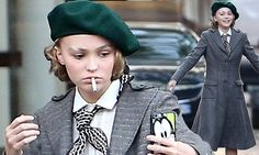 Lily-Rose Depp puffs on a cigarette as she films Planetarium in Paris