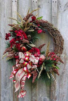 Christmas Wreath, Holiday Wreath, Designer Christmas Wreath, Woodland Holiday Wreath, Ornament Wreath, Elegant Christmas Wreath Berkshires Merry Christmas Wreath. The natural beauty of the woodlands is featured in a lush gathering of long needle silk pine boughs mingling with meadow grass, set upon a rustic grapevine frame. Deep crimson red Hydrangeas, glittered gold pine cones and sprays are accented by a stunning collection of red and gold ornaments adding a classy and festive touch to…