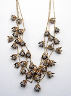 Gold LILY of the VALLEY FLORAL charm necklace. Multi chain statement necklace. Gold flower necklace. Bridal, vintage style necklace. $125.00, via Etsy.