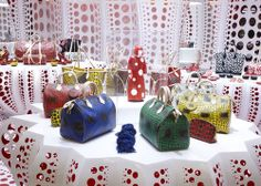Ooh- the black and white is divine!  Louis Vuitton's London, Paris and New York Pop-Up store-outfits, rolled out to coincide with the Maison's collaboration with Yayoi Kusama
