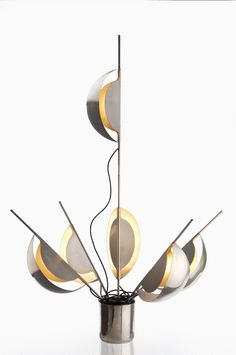JEAN-PIERRE VITRAC Adjustable table lamp, ca. 1970 Stainless steel. 55 1/2 in. (141 cm.) high, 13 in. (33 cm.) diameter, fully extended Manufactured by Verre Lumière, France.   SOLD FOR $27,500