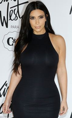 Nice shape:The 34-year-old Keeping Up With The Kardashians star looked pretty as she showed off a tiny waistline in a semi-sheer black dress