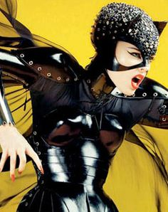 Catwoman Movie Costumes and High Fashion: Dolce and Gabanna's take on Catwoman costume for Vogue: complete with the iconic and indispensable cat cowl studded in Swarovski crystals—meow!