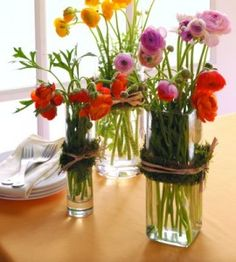 Add a few decorations to the glassware already in your cabinet to create these easy DIY flower vase arrangements.