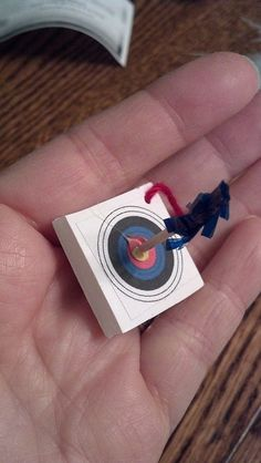 Target with arrow made from frilly toothpick  swaps: one of my favorites!, via Flickr.