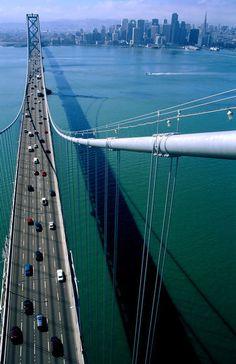 City and San Francisco-Oakland Bay Bridge from tower of bridge