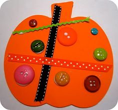 simple and adorable pumpkins - great preschool sensory pumpkin craft - use colorful buttons and ribbons to glue onto precut pumpkin shape