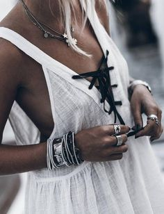 white tunic. silver jewellery.