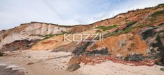 scenic image of cliffs at beach. - Scenic image of cliffs at beach with sky in background.