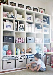 Ikea Expedit bookcase backed with paper for pop --For playroom-craft room Cube Storage, Storage Shelves, Playroom Storage, Ikea Storage, Office Playroom, Ikea Shelves, Nursery Storage, Basement Storage, Office Storage