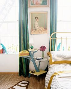 I've always had a fancy for mustard yellow, I'm in love with the bedspread...and the old school phone on the table : )