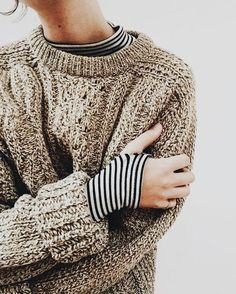 chunky sweater with striped shirt underneath