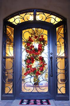 I know this should be in my Christmas board, but this front door is what caught my eye - it is magnificent - wow!