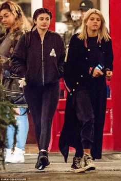 Here come the girls: She was joined by her good friend Sofia Richie, 17, who covered up in a trendy ensemble