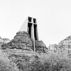 Chapel of the Holy Cross 1956 in Sedona AZ by architect Richard Hein. It is an absolutely strikingly beautiful structure which creates a strong dialog with the rough rock walls that surround it. The design works because it is radically simple with walls sloping slightly outward and the prominent cross on the front facade. The form would be characterized as Brutalist both due to it exposed concrete construction and blocky form. (When you visit the site you will see that it isn't quite as…