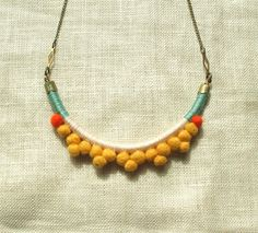 The FRANKIE Necklace Color Study No. 07--Handmade with Felted Wool Pom Poms, Cotton, Leather, and Brass. via Etsy.