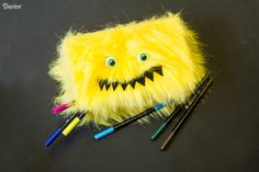 Looking for a fun Back-To-School project? This monster DIY pencil box is a breeze to put together & a fun way to store all their pencils, pens, & markers.