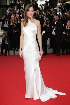 Cannes Film Festival 2014 Hilary Swank's fitted one-shoulder gown looks sleek and elegant as she attends The Homesman film premier.
