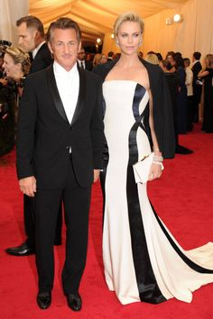 Charlize Theron wore a white Dior Couture gown with black piping and had a suit jacket at the Met Gala 2014 with Sean Penn Celebrity Couples, Celebrity Dresses, Celebrity Style, Celebrity Pics, Sean Penn, Charlize Theron, Vestido Dress, Stylish Couple, White Gowns