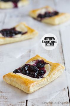 Blueberry Cream Cheese Pastries - Puff pastry is topped with sweetened cream cheese and a blueberry mixture for a perfectly decadent breakfast treat.