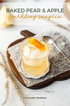 A sparkling sangria recipe with baked pears, baked apples, cinnamon, fresh citrus, apple brandy, orange liqueur, and ginger beer. Perfect for fall! #fallsangria #whitesangria #sangria #sangriarecipe #falldrinks #pears #apples via @aflavorjournal