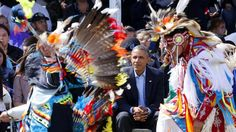 President Obama watches Native American dancers on the Standing Rock Indian Reservation today