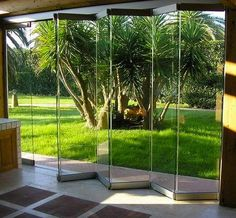 There are various styles of patio sliding doors, but the most prevalent will have an immobile door panel and a sliding door that is used as the entrance. Mostly doors consist of a thick glass panel to allow people to have a good view of the outside a Garden Room, Garden Doors, Exterior Doors, Folding Glass Doors, Door Design, Frameless Glass Doors, Folding Doors, Glass Room, Exterior