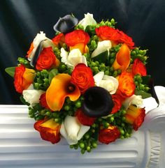 A beautiful Brides wedding bouquet of Hawaiian Delight Roses,with Orange & Purple Callas, & Hypercium Green berries Wedding 2015, Wedding Bride, Bride Bouquets, Orange And Purple, Beautiful Bride, Hawaiian, Brides, Floral Wreath, Table Decorations