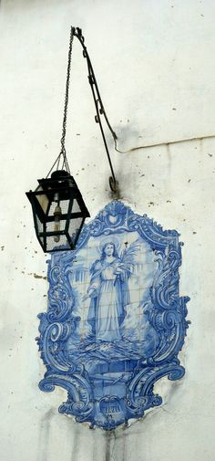 Tiles and a lamp in Alfama, Lisbon