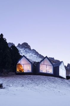 A gorgeous Swiss mountain restaurant designed by architects Peter Pichler and Pavol Mikolajcak features three large huts, each facing a different mountain.
