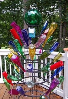 Bottle tree on the deck of blogger Susanbetweennapsontheporch.  Love it!  I know, it's a southern thing.