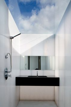 Discover small bathroom design ideas on HOUSE - design, food and travel by House & Garden. A glazed ceiling floods the room with light, offering views of the sky while retaining privacy.