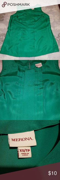 Emerald Green Ruffle Blouse Emerald green ruffle blouse in great condition.  Looks great with skinny jeans or pencil skirt. 100% Polyester ...  OPEN TO OFFERS Merona Tops Blouses
