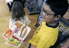Clamping down: The rules includes snacks sold around the school and foods on the a la carte line in cafeterias (library image of a fifth grader at a New Jersey school cafeteria)