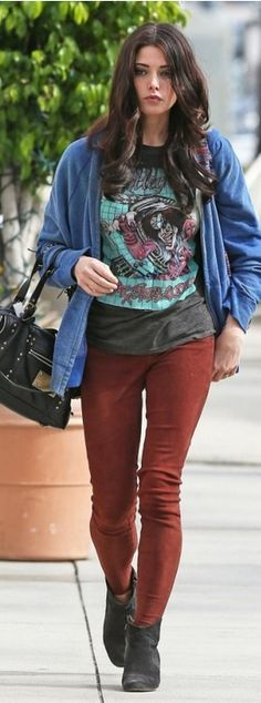 Who made Ashley Greene's print top, red velvet skinny jeans, black suede boots, and black handbag? Purse – Louis Vuitton and FEED  Pants – Lucky Brand  Shoes – Isabel Marnt  Shirt – Motley Crue