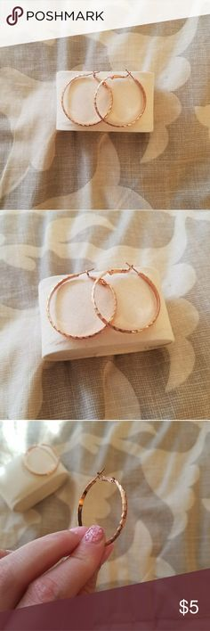 Jewelry SALE!! 💛Earrings💛 These rose gold colored hoop earrings are super light! I wore them for maybe 20 minutes then took them off because I kept yanking them with my fingers. I guess I'm only a stud earring girl! Jewelry Earrings