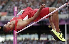 Ashton Eaton clears the bar in the heptathlon high jump